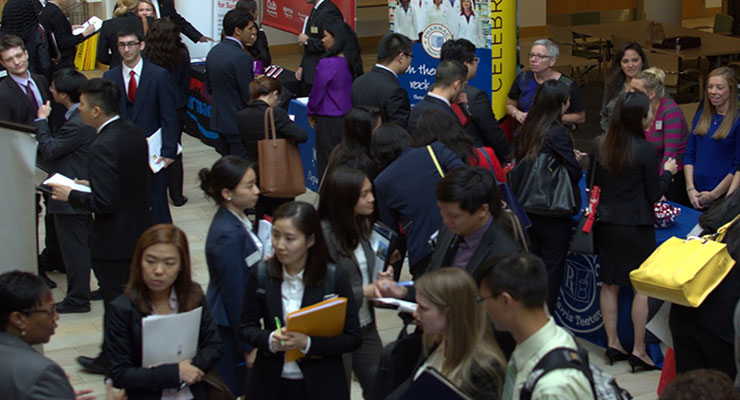 Fourth-year student pharmacists gather in Pharmacy Hall for the 2016 Career Fair.